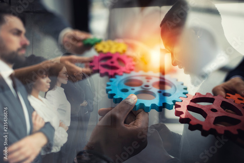 Foto Murales Business team connect pieces of gears. Teamwork, partnership and integration concept. double exposure