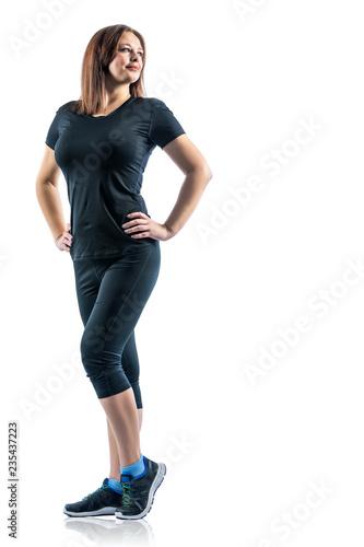Zdrowy i sprawności fizycznej pojęcie - portret pozuje z sprawnością fizyczną dziewczyna odziewa nad białym pracownianym tłem.