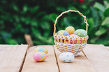 Colorful easter eggs in basket on wooden table win copy space. - 235446465