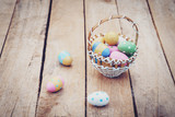 Colorful easter eggs in basket on wooden table win copy space. - 235446486