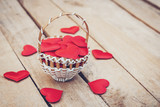 Red heart in basket on wooden table for valentine day and love concept with copy space. - 235446604