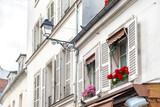 Windows with flowers on Montmartre street
