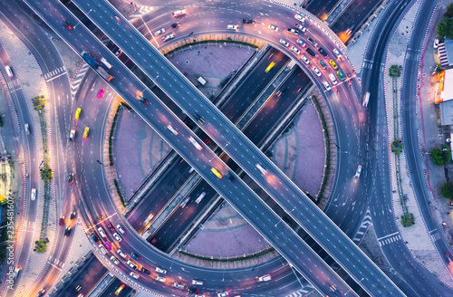 Aerial view and top view of traffic on city streets in bangkok , thailand. Expressway with car lots. - 235481607