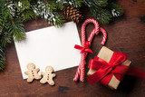 Christmas card with gift box and fir tree