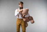 A man with roses and a big toy bear
