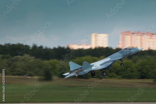 fototapeta na ścianę Modern jet fighter take off with landing gear