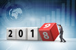 Leinwanddruck Bild - Businessman employee rotating cube to reveal number 2019