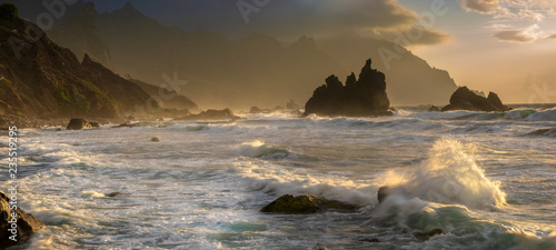 Leinwanddruck Bild Wild Tenerife beach.Dramatic shot of ocean waves crashing against rocks