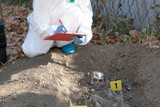 Exhumation: Forensic science specialist at work