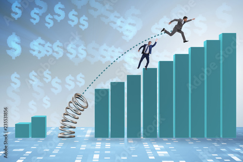 Leinwandbild Motiv Businessman outperforming his competition jumping over