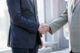 Business handshake close up - 235537625