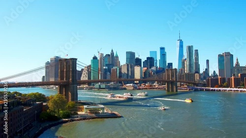 Waterfront view of downtown Manhattan with Brooklyn Bridge and financial district skyscrapers in New York City