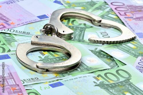 Leinwandbild Motiv Police handcuffs on euro banknotes - corruption concept