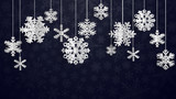 Christmas illustration with white three-dimensional paper snowflakes hanging on black background