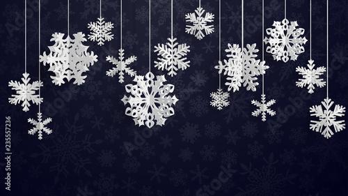 Bożenarodzeniowa ilustracja z białymi trójwymiarowymi papierowymi płatkami śniegu wiesza na czarnym tle