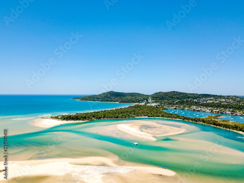 Leinwandbild Motiv Noosa river aerial view with vibrant blue water on the Sunshine Coast in Queensland, Australia