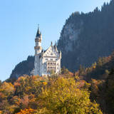Neuschwanstein Castle on the mountain over blue sky © bankerwin