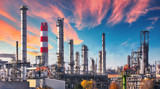 Pipeline and pipe rack of petroleum industrial plant with sunset sky background - 235632212