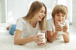 Leinwandbild Motiv Family drinking milk