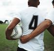 Leinwandbild Motiv Football player in a number 4 jersey