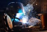 Welder working in workshop factory - 235657640