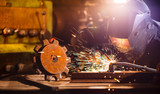 Welder working in workshop factory - 235657816