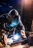 Welder working in workshop factory - 235658045