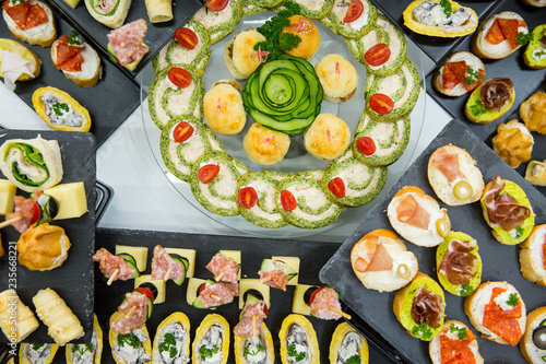 different types of catering canapes on buffet - 235668221
