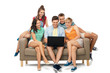 friendship, leisure and technology concept - group of happy smiling friends with laptop computer sitting on sofa over white background