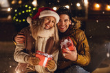 Cheerful young couple dressed in winter clothing