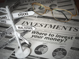 Investmments and asset allocation concept. Where to Invest? Newspaper and direction sign with investment options. - 235700232