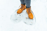 woman winter boots on snow close up - 235702213