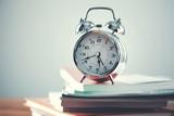 vintage clock on book - 235704854