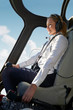 Female Pilot In Cockpit Of Helicopter During Flight