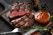 Leinwandbild Motiv Sliced grilled medium rare beef steak served on wooden board Barbecue, bbq meat beef tenderloin.