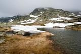 Deshielo primaveral en el macizo montañoso de Peñalara en la Laguna de los Pájaros. Madrid. España - 235714434