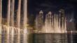 canvas print picture - Skyline von Dubai in der Nacht als Nachtaufnahme