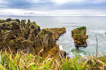Sea and natural layered rock formations from erosion. Pancake Rocks and Blowholes, Paparoa National Park, West Coast, near Hokitika, New Zealand. © Roberto