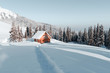 Leinwanddruck Bild - Fantastic winter landscape with wooden house in snowy mountains. Christmas holiday concept. Carpathians mountain, Ukraine, Europe