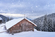 Fantastic winter landscape with wooden house in snowy mountains. Christmas holiday concept. Carpathians mountain, Ukraine, Europe - 235728862