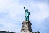 majestic Statue of liberty against a blue sky. New York, USA © konoplizkaya