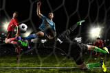 Fototapeta Sport - Football player in action on a dark arena © Andrey Burmakin