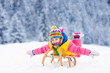 Leinwandbild Motiv Girl on sleigh ride. Child sledding. Kid with sledge