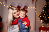 Mother and son celebrate christmas at home