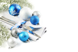Kitchen cutlery with napkin and christmas decorations on white background