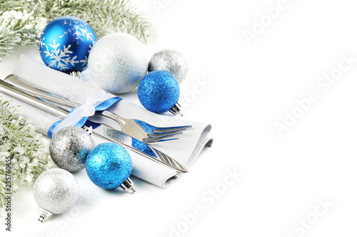 Kitchen cutlery with napkin and christmas decorations on white background - 235760455