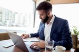 Businessman in modern office - 235769408