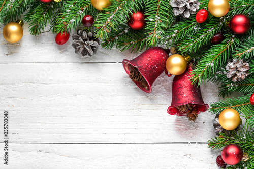 christmas or happy new year background made of fir branches decorations red berries and