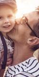 Beautiful portrait of a cute little boy hugging his dad - 235785695