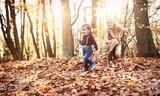 Joyful family enjoying great, autumnal weather - 235786210